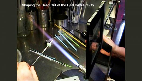 Shaping the bead out of the heat using gravity