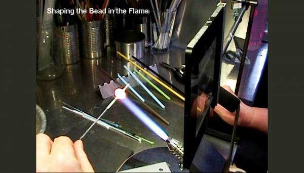 Shaping the bead in the flame
