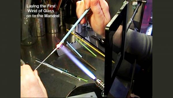 Laying the first wind of glass onto the mandrel